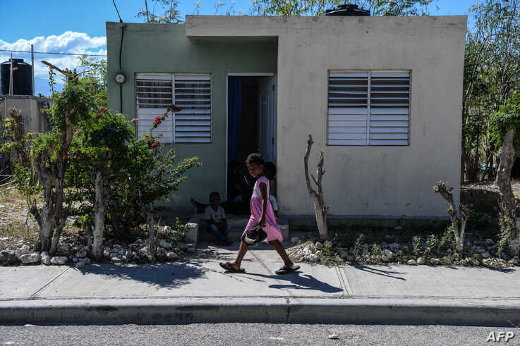 (FILES) In this file photo taken on December 30, 2019 A girl walks in Croix des Bouquets, Haiti