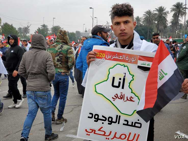 "This protesters sign says ""I am an Iraqi against the presence of America on Jan. 24, 2020 in Baghdad. (H.Murdock/VOA)"