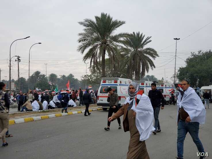 Ambulances line up outside the protest during morning hours on Jan. 24, 2020 in Baghdad. (H.Murdock/VOA)