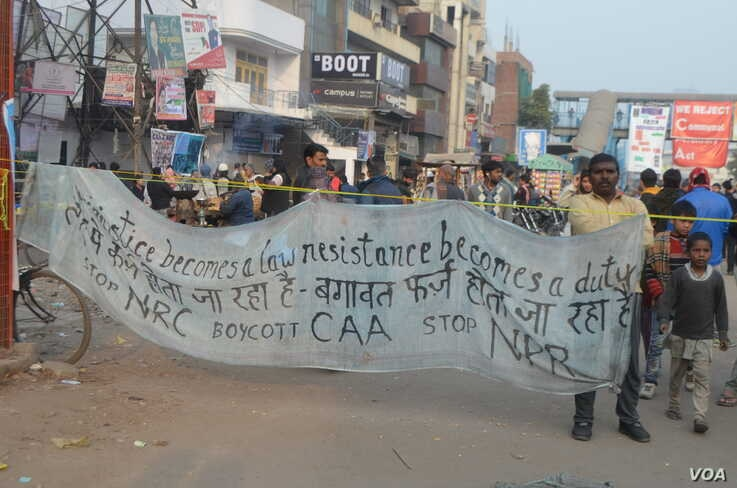 A banner hangs in Shaheen Bagh, where women are vowing to continue to protest the citizenship law in India. (Anjana Pasricha/VOA)