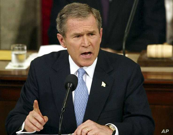 """FILE - In this Jan. 29. 2002, file photo, President George W. Bush labels North Korea, Iran and Iraq an """"axis of evil"""" during…"""