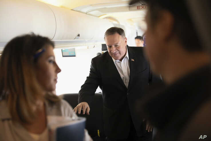 FILE - U.S. Secretary of State Mike Pompeo walks towards reporters to speak aboard his plane en route to Thailand