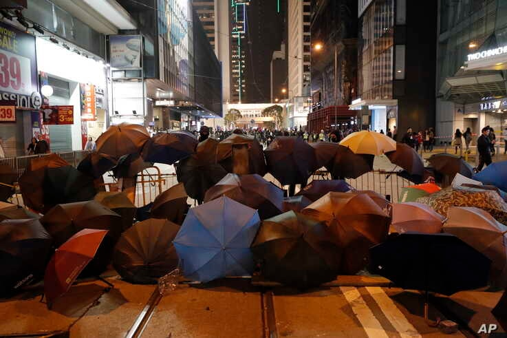 Protesters set up barricades with debris and umbrellas in Hong Kong, Jan. 1, 2020.