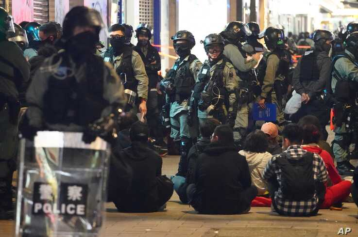 Police detain protesters in Hong Kong, Wednesday, Jan. 1, 2020. Hong Kong toned down its New Year's celebrations amid the…