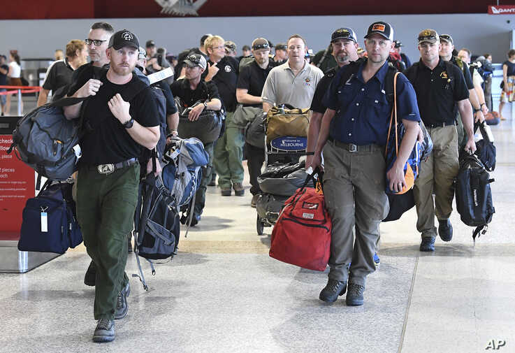A contingent of 39 firefighters from the United states and Canada arrive at Melbourne Airport in Melbourne, Thursday, January 2…