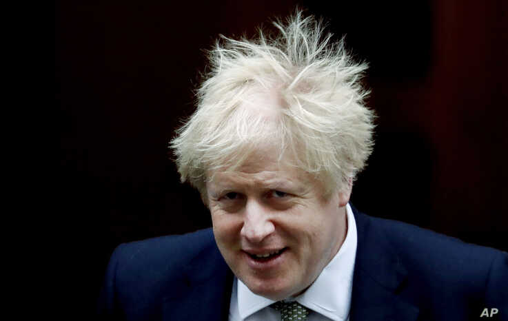 FILE - Britain's Prime Minister Boris Johnson leaves Downing Street for the State Opening of Parliament by Queen Elizabeth II, in the House of Lords at the Palace of Westminster in London, Dec. 19, 2019.