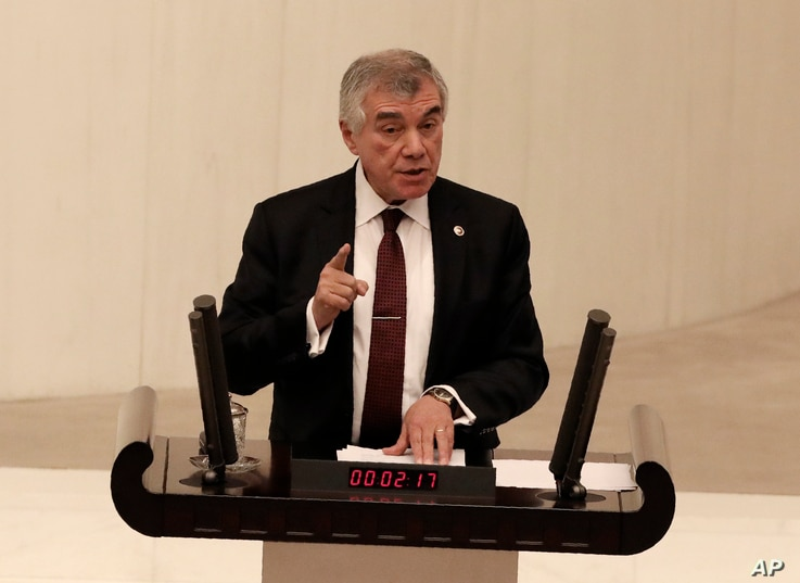 Unal Cevikoz, a lawmaker of the main opposition Republican People's Party, speaks before Turkey's parliament authorized the…