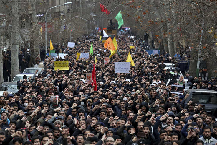 Protesters demonstrate over the U.S. airstrike in Iraq that killed Iranian Revolutionary Guard Gen. Qassem Soleimani in Tehran, Iran, Jan. 4, 2020.