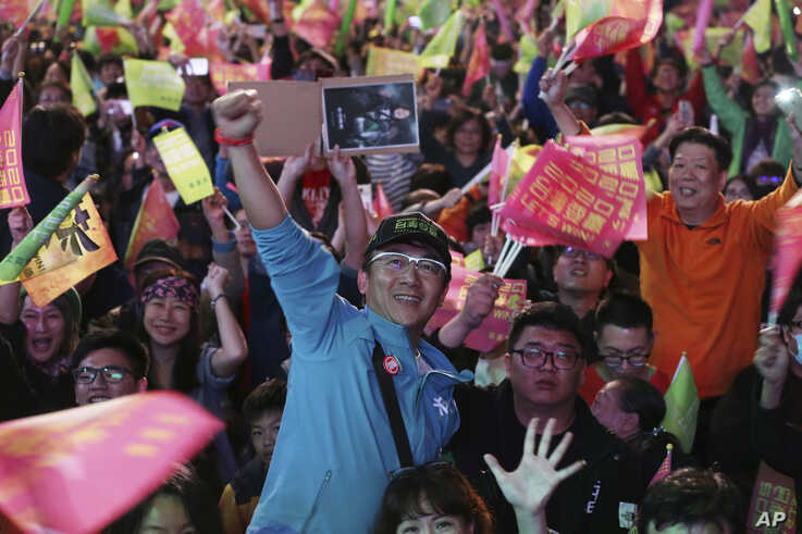 Supporters of Taiwan's 2020 presidential election candidate, Taiwan president Tsai Ing-wen cheer for Tsai's victory in Taipei, Taiwan, Jan. 11, 2020.