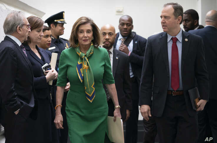 Speaker of the House Nancy Pelosi, D-Calif., joined by House Intelligence Committee Chairman Adam Schiff, D-Calif., right