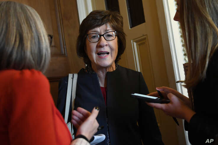 FILE - Sen. Susan Collins, R-Maine, talks to reporters on Capitol Hill in Washington.