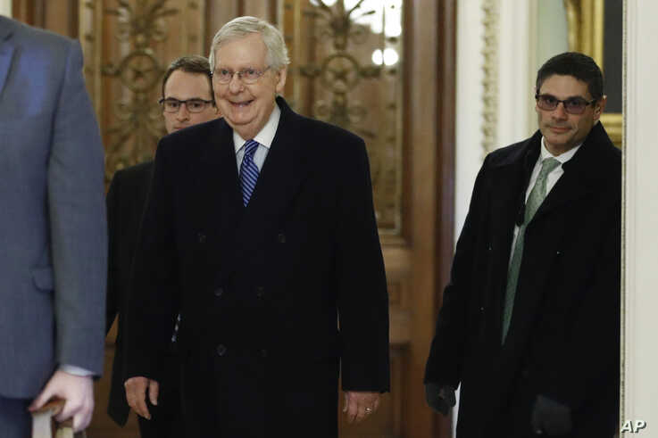 Senate Majority Leader Mitch McConnell, R-Ky., walks past the entrance to the Senate chamber as he arrives at his office