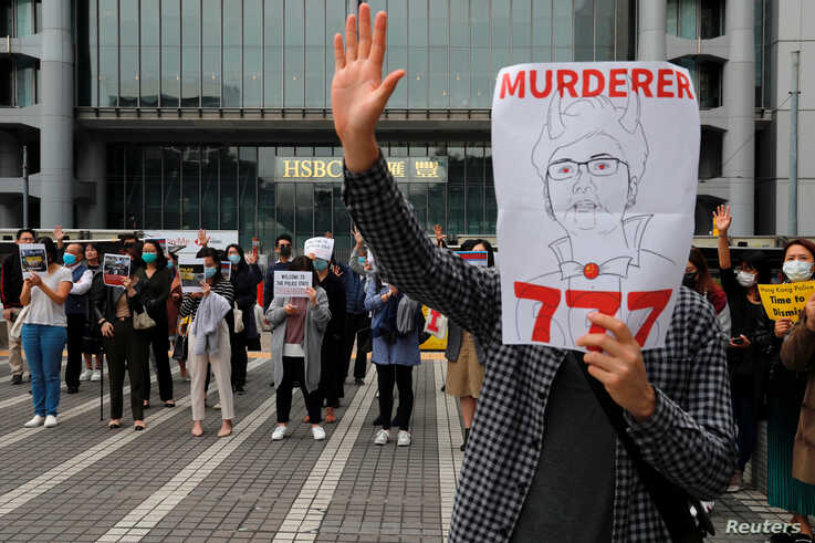 Anti-government protesters take part at a lunchtime protest outside HSBC headquarters in Hong Kong, China January 2, 2020…