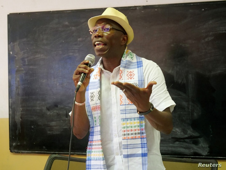FILE PHOTO: Presidential candidate Domingos Simoes Pereira holds a meeting with students at Lusophone university in Bissau,…
