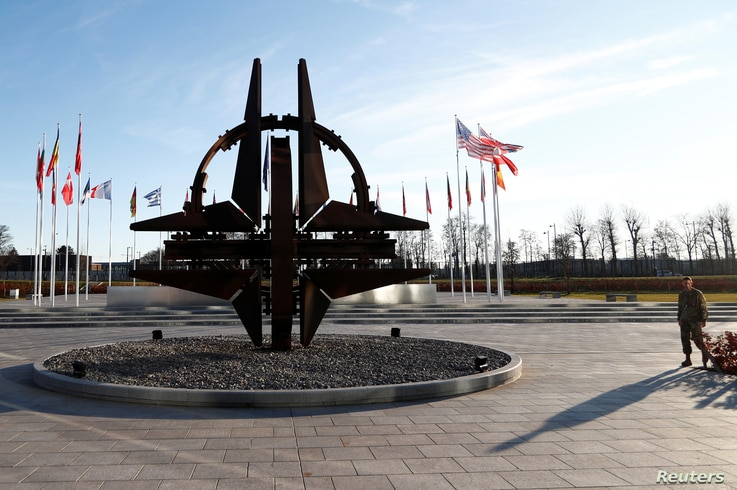 A man stands outside NATO headquarters in Brussels, Belgium January 6, 2020. REUTERS/Francois Lenoir - RC2FAE9HH6B4