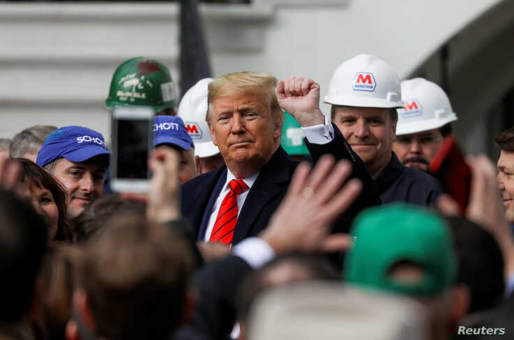 U.S. President Donald Trump acknowledges a gestures during a signing ceremony for the United States-Mexico-Canada Trade…