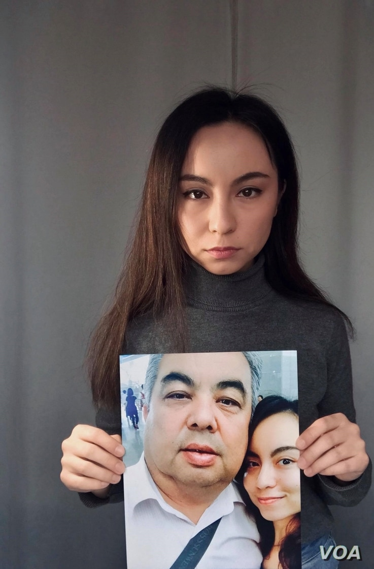 Picture Caption:  Image shows exiled Uighur Samira Imin holding a picture of her father, Iminjan Seydin, who went missing in China's Xinjiang province in 2017. Photo curtesy of Samira Imin.
