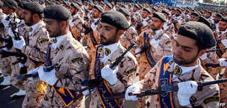 Members of Iran's Revolutionary Guards Corps (IRGC) march during the annual military parade marking the anniversary of the…