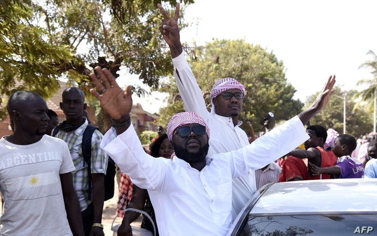 Supporters of newly elected President Umaro Sissoco Embalo celebrate, Jan. 1, 2020, in Bissau after the anouncement of the election results.