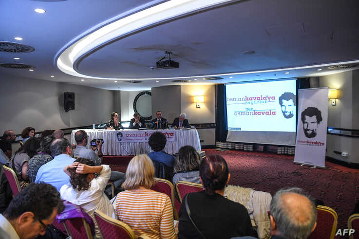 FILE - Lawyers for jailed philanthropist Osman Kavala hold a press conference in Istanbul, Turkey, Oct. 31, 2018.