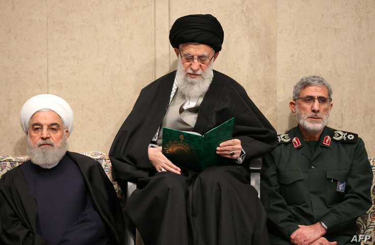 This handout picture provided by the office of Iran's Supreme Leader Ayatollah Ali Khamenei Jan. 9, 2020, shows him (C) alongside President Hassan Rouhani (L) and the newly-appointed commander of the Quds Force Esmail Qaani, in Tehran, Iran.