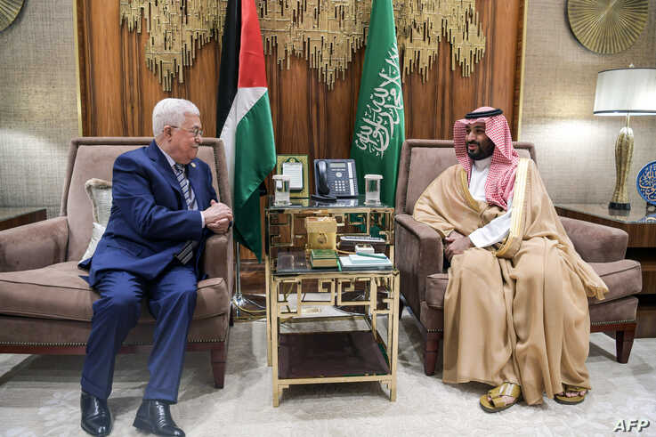 A handout picture provided by the Palestinian Authority's press office (PPO) Oct. 17, 2019, shows Saudi Crown Prince Mohammed bin Salman (R) meeting with Palestinian Authority President Mahmoud Abbas, in the Saudi capital Riyadh.