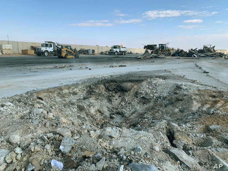 A crater is seen at Ain al-Asad air base, in Anbar, Iraq, Jan. 13, 2020, following an Iranian missile attack. The Pentagon now says 50 U.S. service members have been diagnosed with traumatic brain injury caused by the Jan. 8 attack.
