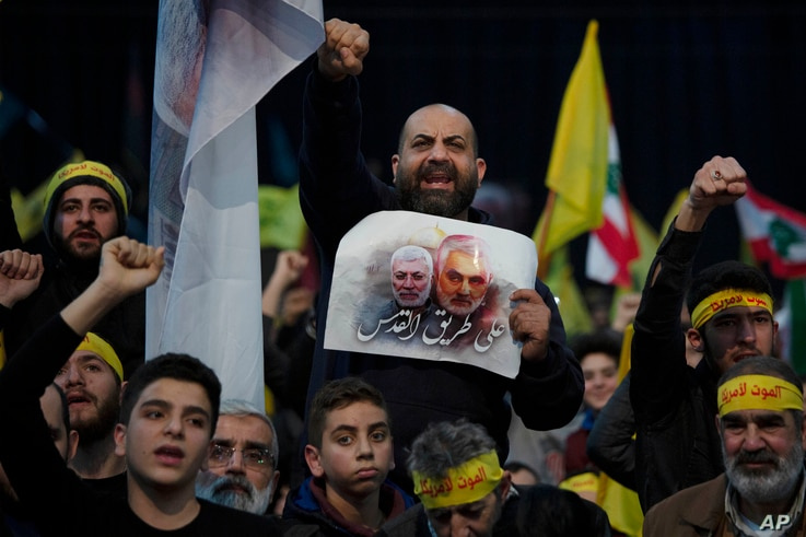 Supporters of Hezbollah leader Sayyed Hassan Nasrallah chant slogans in a southern suburb of Beirut, Lebanon, Jan. 5, 2020, following the U.S. airstrike in Iraq that killed Iranian Revolutionary Guard Gen. Qassem Soleimani.
