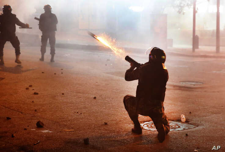 A riot policeman fires tear gas against the anti-aA riot policeman fires tear gas against the anti-government protesters, during ongoing protests against the Lebanese central bank's governor and the deepening financial crisis, at Hamra trade street, in Beirut, Lebanon, Jan. 14, 2020.overnment protesters, during ongoing protests against the Lebanese central…