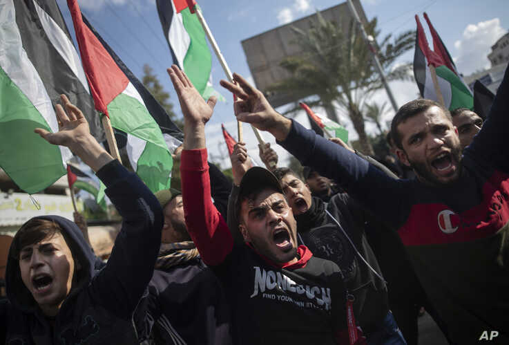 Palestinian protesters chant angry slogans during a protest against a new U.S. Mideast peace plan, in Gaza City, Jan. 28, 2020.
