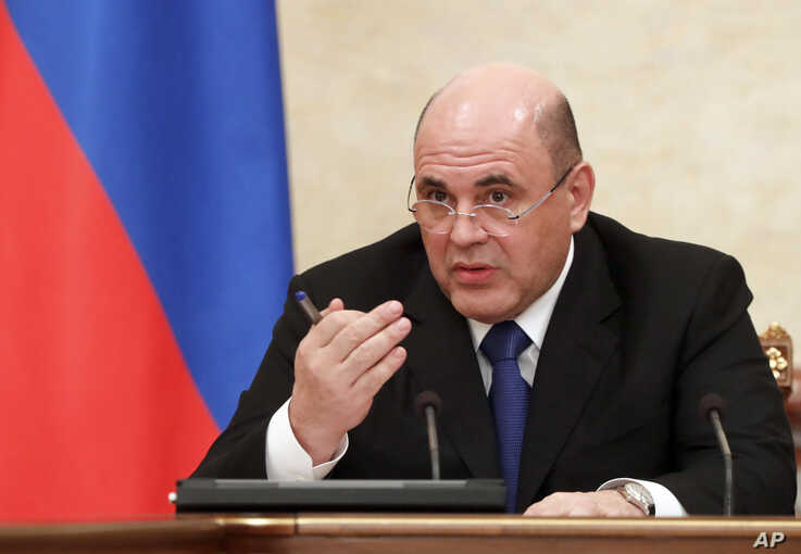 Russian Prime Minister Mikhail Mishustin speaks during a cabinet meeting in Moscow, Jan. 30, 2020.