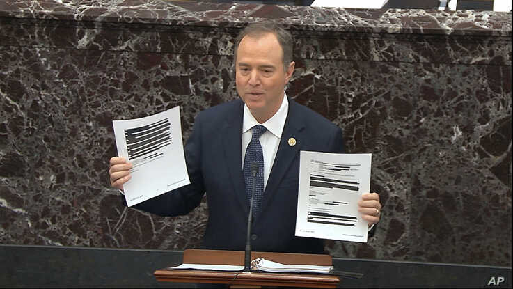 In this image from video, House impeachment manager Rep. Adam Schiff holds redacted documents as he speaks during the impeachment trial of President Donald Trump, in the Senate at the Capitol in Washington, Jan. 22, 2020.