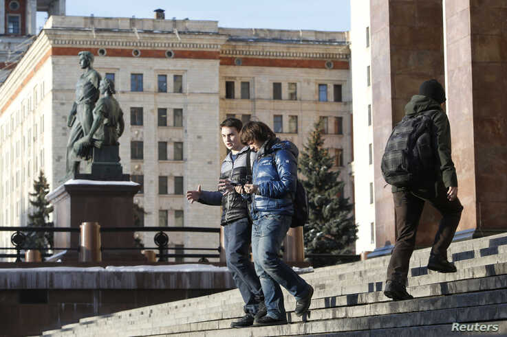 FILE - Students walk outside the main building of Moscow State University, in Moscow, Russia, Feb. 10, 2015.