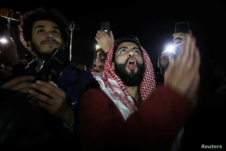 Protesters shout slogans during a protest against U.S. President Donald Trump's proposed Middle East peace plan, near the U.S. Embassy in Amman, Jordan, Jan. 28, 2020.