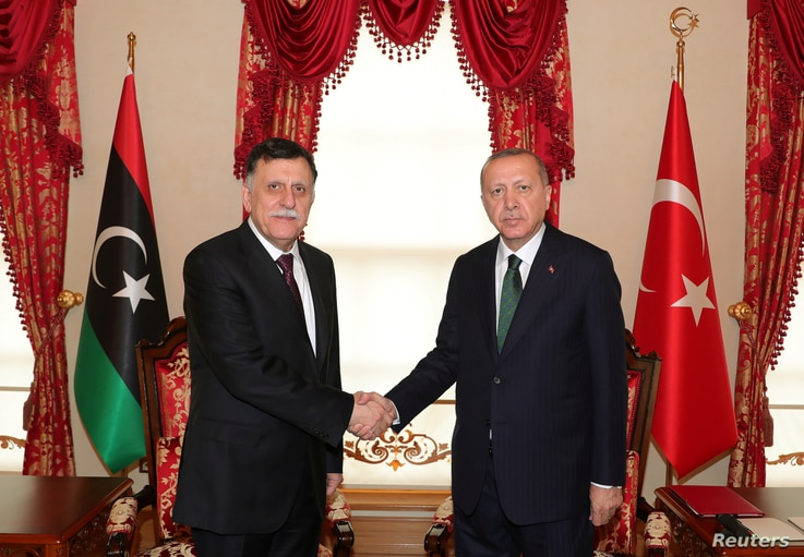 Turkish President Tayyip Erdogan meets with Libya's U.N.-recognized Prime Minister Fayez al-Sarraj in Istanbul, Turkey, Jan. 12, 2020.