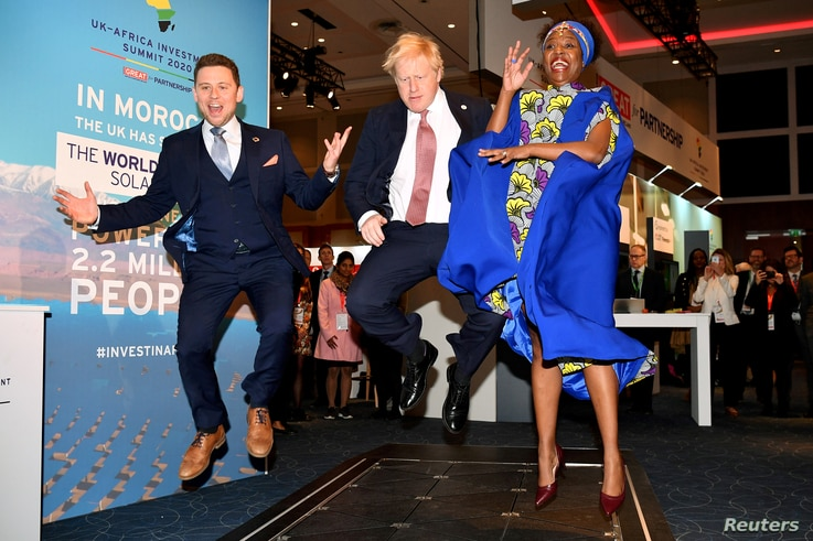 British Prime Minister Boris Johnson visits the Pavegen stand, a company that converts footsteps into energy, at the Innovation Zone during the UK-Africa Investment Summit in London.