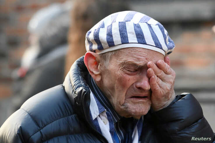 A survivor reacts at the former Nazi German concentration and extermination camp Auschwitz as he attends a wreath-laying ceremony, marking the 75th anniversary of the liberation of the camp, in Oswiecim, Poland, Jan. 27, 2020.