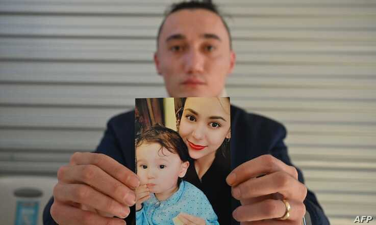 Australian Uighur Sadam Abdusalam holds up a photo of his wife Nadila and their toddler son Lutfi, whom he has never met. He is trying to get them released from China.