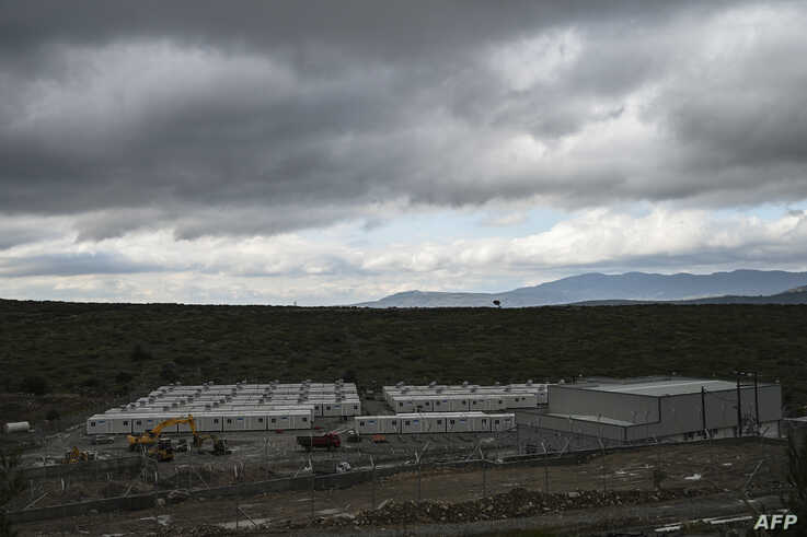 A new closed camp for migrants with a capacity of 1200 people is pictured in Zervou, on the island of Samos on February 21,…