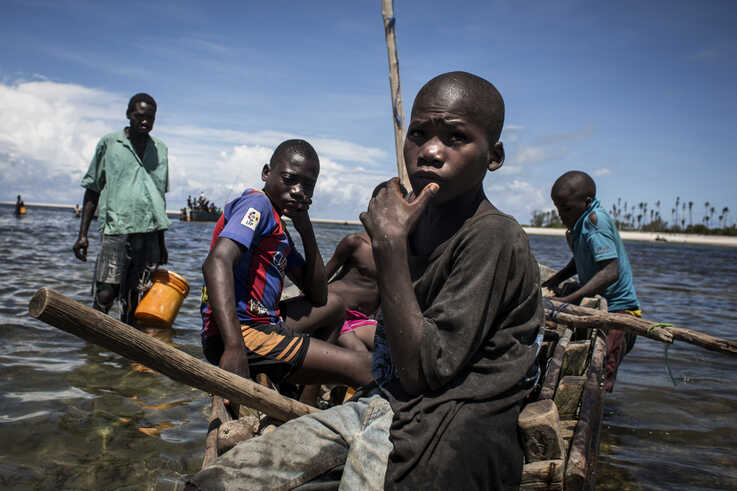 Young Mozambican fishermen return to the shore after several days of fishing in Palma, where large deposits of natural gas where found offshore, Feb. 16, 2017.