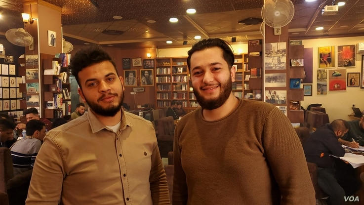 Abdulrahman, left, and his friend Ali say they agree with the protesters' demands but the streets of Mosul, Iraq, are too volatile to stage protests, Jan. 29, 2020. (H.Murdock/VOA)