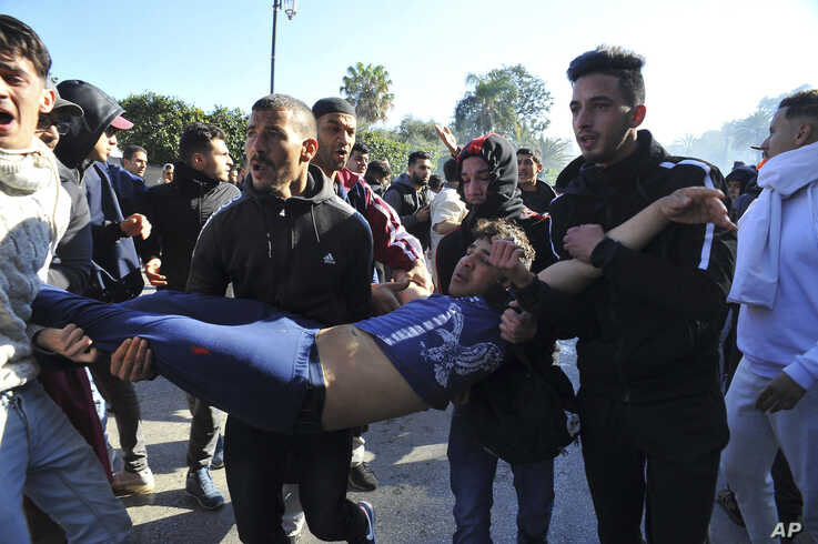 A wounded protester is being evacuated during a demonstration to denounce President Abdelaziz Bouteflika's bid for a fifth term…