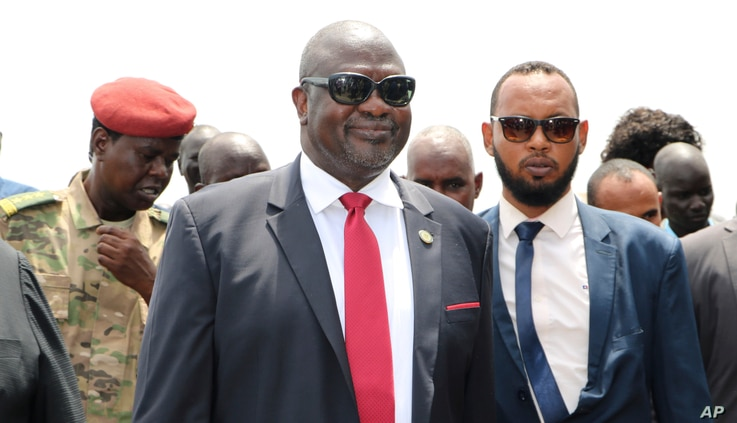 FILE - In this Saturday, Oct. 19, 2019 file photo, South Sudan's opposition leader Riek Machar, center, returns to the country,…