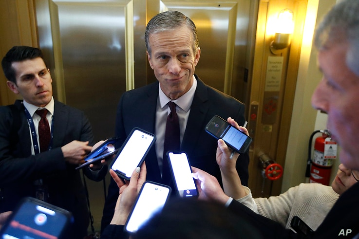 Sen. John Thune, R-S.D., answers reporters questions outside his office prior to the start of the impeachment trial of…