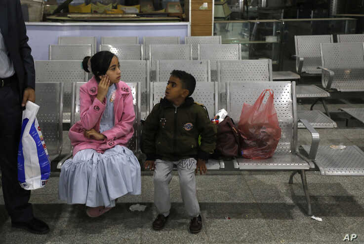 A Yemeni girl and boy wait in the departure lounge at Sanaa International airport, in Yemen, Monday, Feb. 3, 2020. A United…