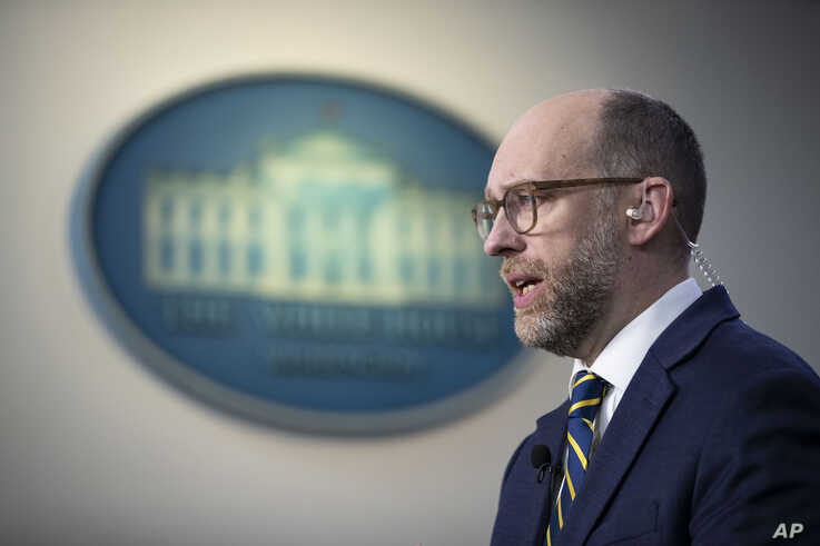 Office of Management and Budget Acting Director Russell Vought speaks during a television interview at the White House, Monday,…