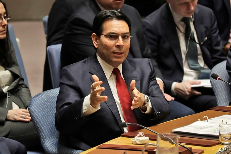 Israeli ambassador to the United Nations Danny Danon speaks during a Security Council meeting at United Nations headquarters,…