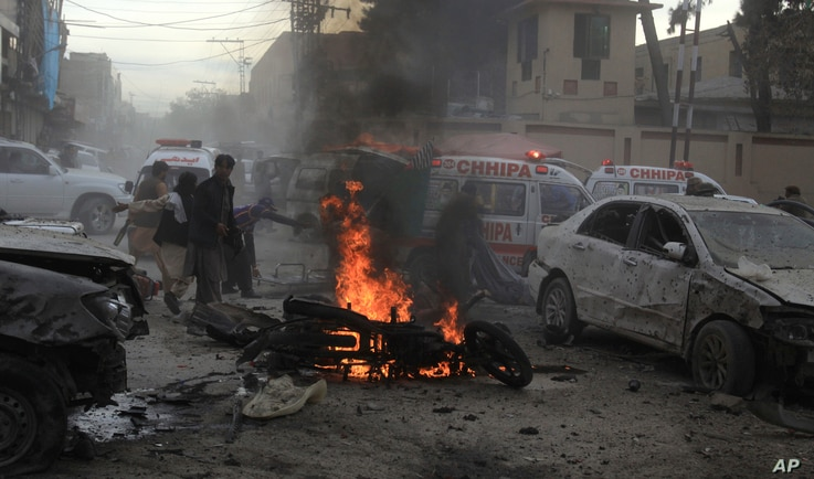 Pakistani rescue workers and volunteers help to remove victims at the site of a suicide bombing in Quetta, Pakistan.
