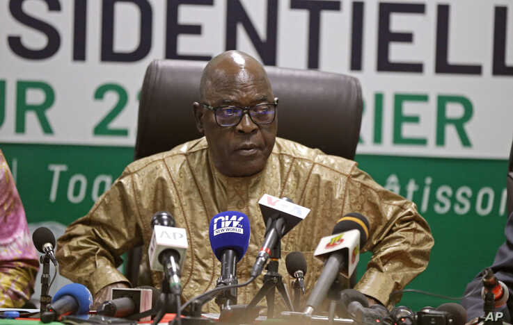 The head of the electoral commission Tchambakou Ayassor announces the winner of the presidential elections in Lome, Togo, Feb. 23, 2020.