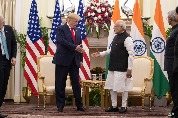 U.S. President Donald Trump and Indian Prime Minister Narendra Modi shake hands before their meeting at Hyderabad House,…